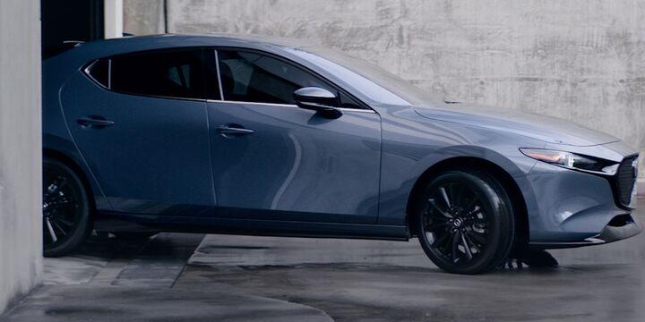 Mazda3 Hatchback leaving garage
