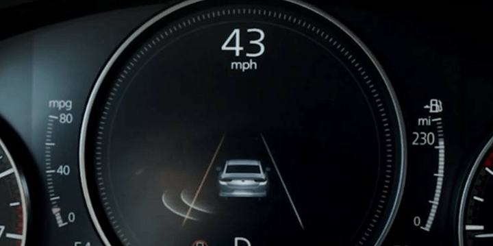 Speedometer on Mazda vehicle dashboard