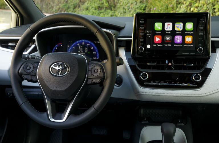 A photo of the driver's cockpit and the touchscreen display in the 2021 Toyota Corolla Hatchback.