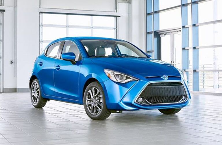 front of blue 2020 Toyota Yaris hatchback