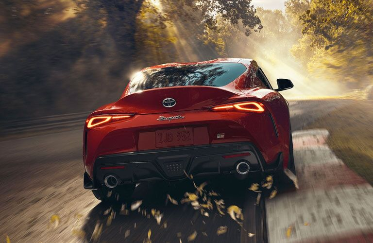 2020 Toyota GR Supra driving and kicking up leaves
