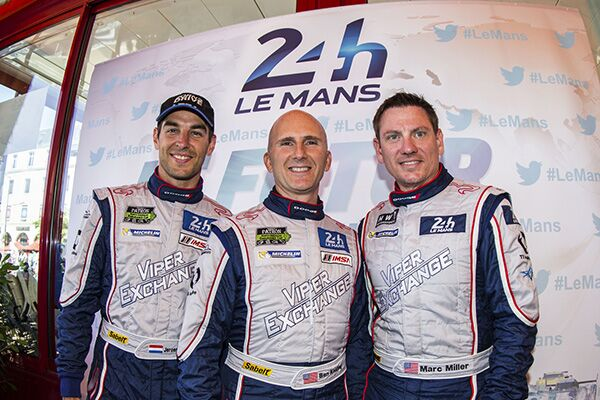 three race car drivers