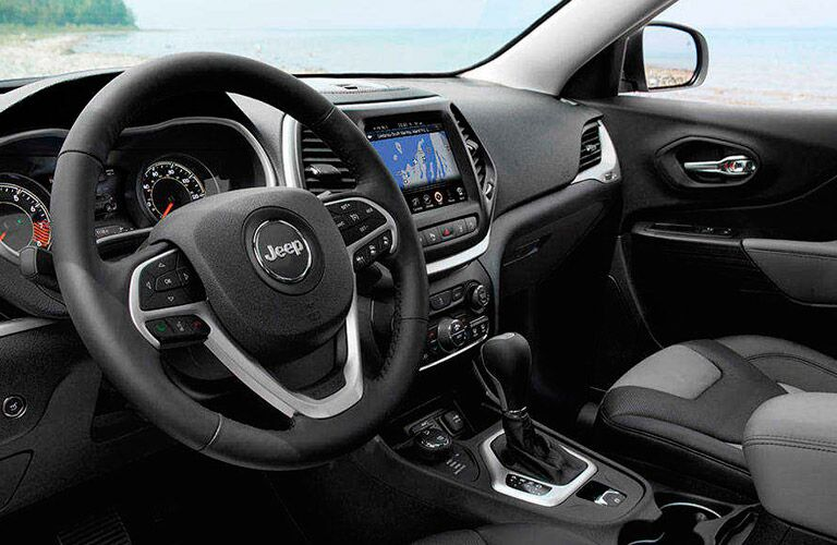 The interior of the 2016 Jeep Cherokee in Albert Lea MN is sporty!
