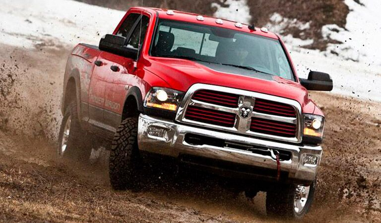 red 2018 Ram 2500 driving through the mud