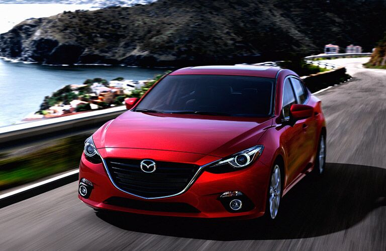 2016 Mazda3 on the road by the lake