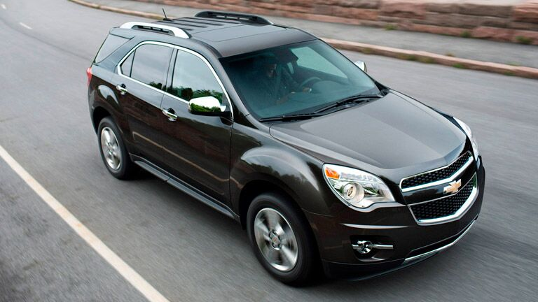 Black 2015 Chevy Equinox on the road
