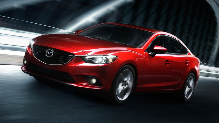 Red Mazda 6 driving