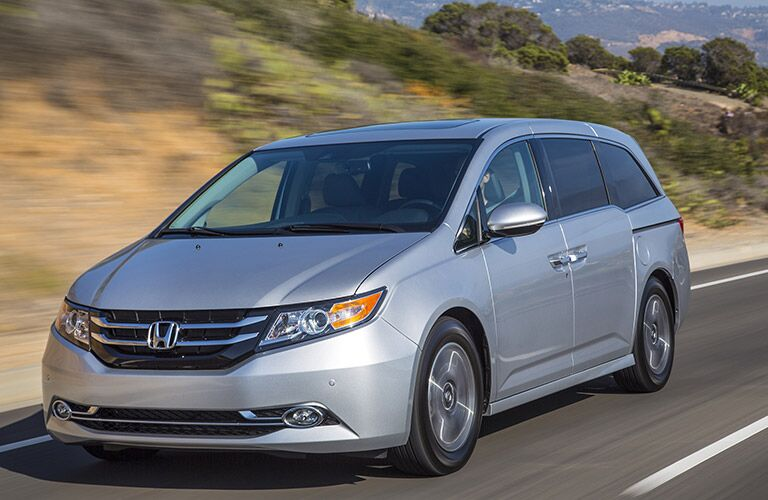 Silver 2016 Honda Odyssey on the road