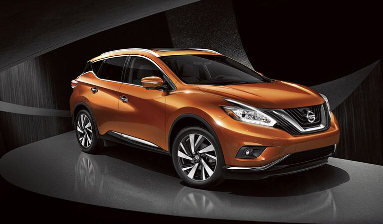 Orange Nissan Murano in the showroom