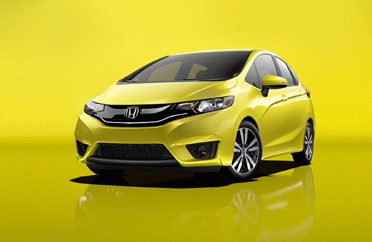 Yellow Honda Fit on Yellow Background
