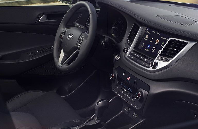 2016 Hyundai Tucson steering wheel and dashboard view