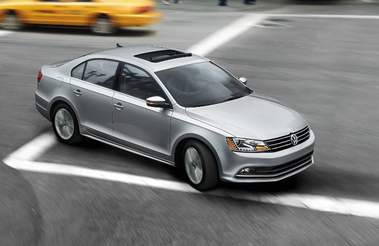 2016 VW Jetta exterior silver driving sunroof