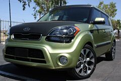 Kia Soul with Matte black hood and custom wheels