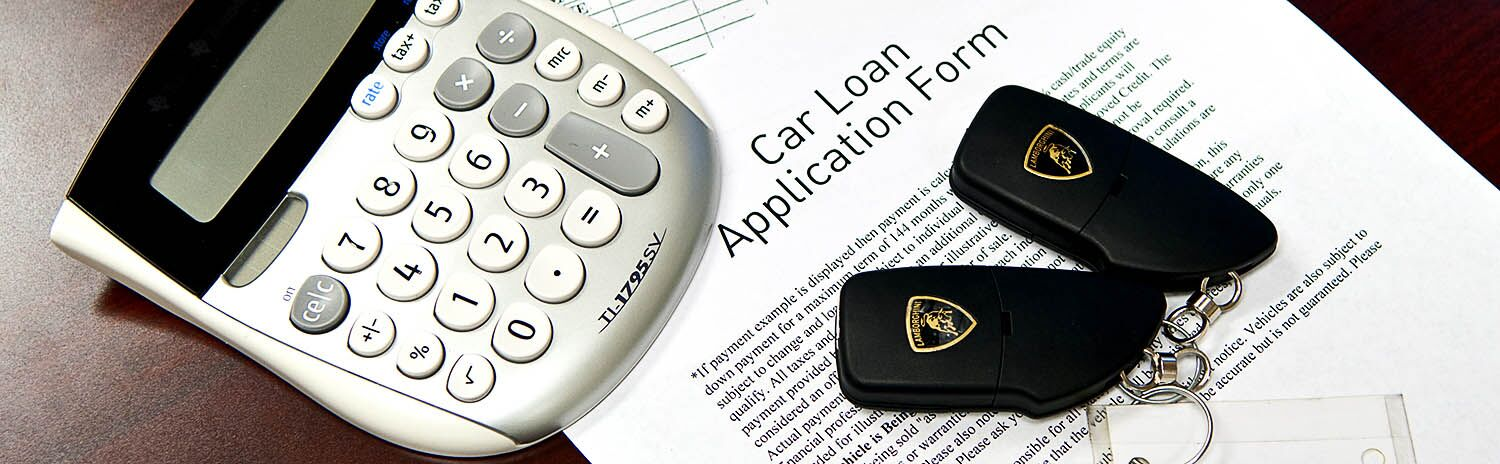 Car Loan Application Form with a calculator and car keys resting on top