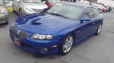PONTIAC GTO 6.0L, CARFAX CERTIFIED, LEATHER, NAVIGATION, REAR SPOILER, FOG LAMPS, VERY LOW MILEAGE AT 64K MILES! 2005