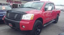NISSAN TITAN SE 4X4, CARFAX CERTIFIED, HEATED LEATHER, SAT, DVD, PARKING SENSORS, SOFT TONNEAU COVER, NICE TRUCK! 2007