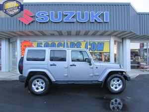 2013 JEEP WRANGLER UNLIMITED SaharaThe Jeep has a V6 36L FFV DOHC high output engine and four