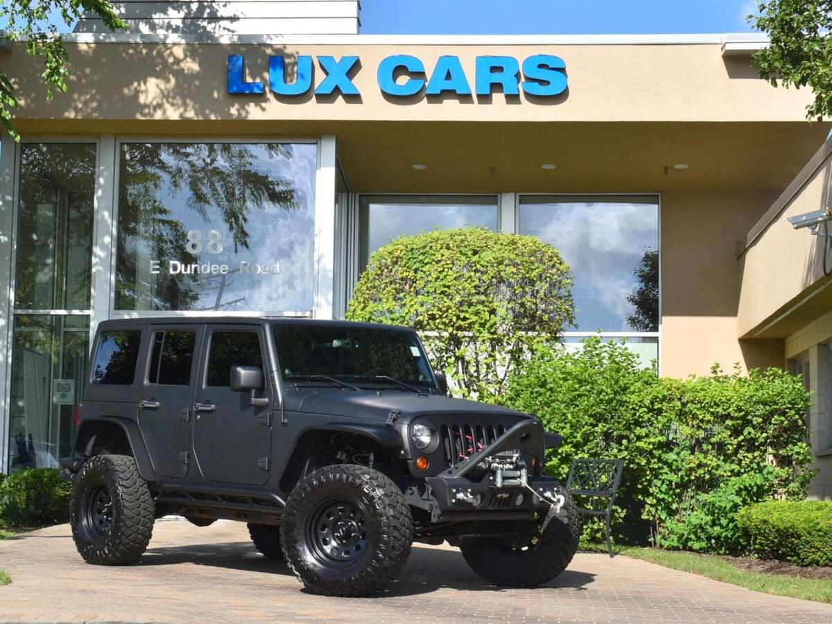 2013_Jeep_Wrangler Unlimited_Sahara Hard Top Nav Lifted 4WD_ Buffalo Grove IL