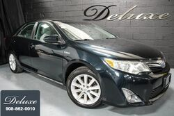 Toyota Camry Hybrid XLE Sedan, Rear-View Camera, Touch-Screen Audio System, In-Dash CD-Player, Leather Seats, Power Sunroof, 17-Inch Alloy Wheels, 2013