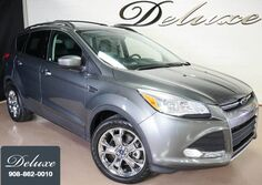 Ford Escape SE, Navigation System, Rear-View Camera, Bluetooth Streaming Audio, Heated Leather Seats, Panorama Sunroof, Power Liftgate, 18-Inch Alloy Wheels, 2014