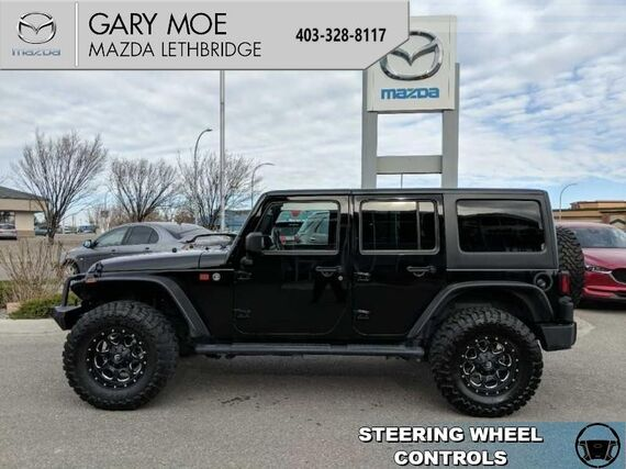 2014_Jeep_Wrangler Unlimited_SPORT  - 35's with a 4