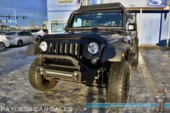 2014_Jeep_Wrangler Unlimited_Sport Willys Edition / 4X4 / Hard Top / 6-Spd Manual / Lifted / Ace Front & Rear Bumpers / LED Lightbar / 33in Tires / Kargo Master Roof Rack & Basket / FACTOR Fuel Tank Carrier / FABTECH Storage Shelf / Leather Seats / Bluetooth / Tow Pkg_ Anchorage AK