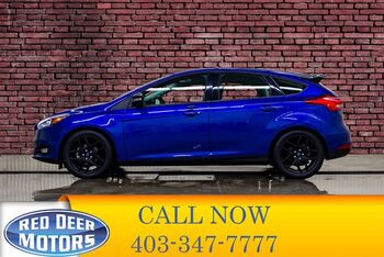 2015_Ford_Focus_SE Hatchback Manual BCam Heated Seats_ Red Deer AB