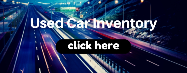 Used Car Inventory click here title with a highway in the background
