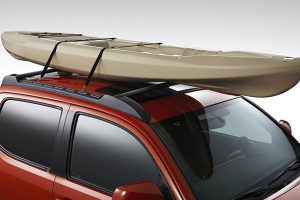 Orange 2016 Toyota Tacoma with Roof Rack and Kayak