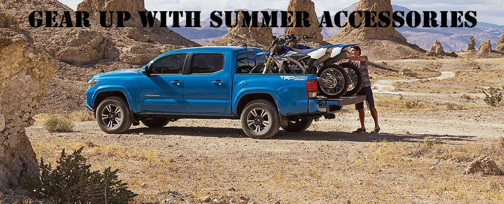 Blue 2016 Toyota Tacoma Off Road with Two Dirt Bikes