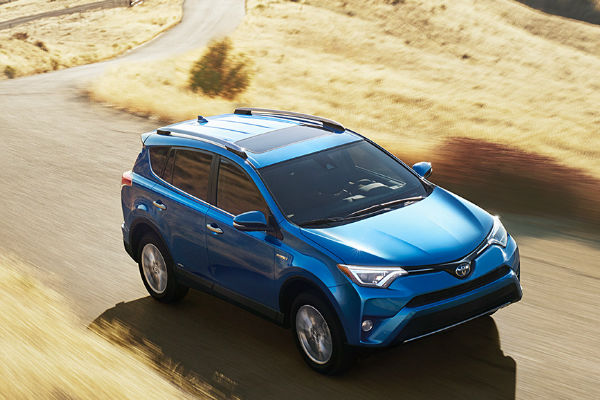 Electric Storm blue 2016 Toyota RAV4 Hybrid Limited on the Road