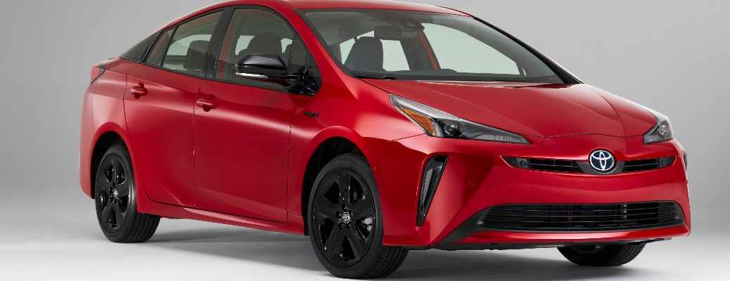 Passenger's side front angle view of red 2021 Toyota Prius