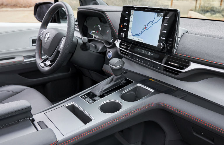 Steering wheel, gauges, and touchscreen in 2021 Toyota Sienna