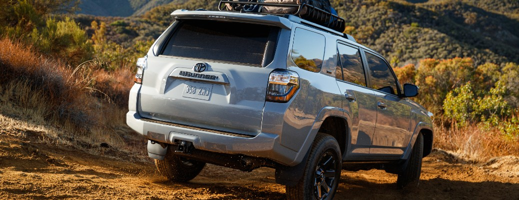 Silver 2021 Toyota 4Runner driving down a hill