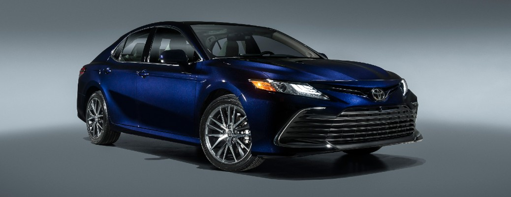 Passenger's side front angle view of blue 2021 Toyota Camry