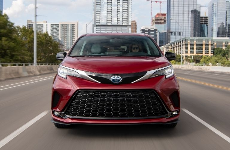 2021 Toyota Sienna head-on driving away from city