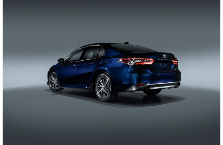 Rear view look at a 2021 Toyota Camry color blue