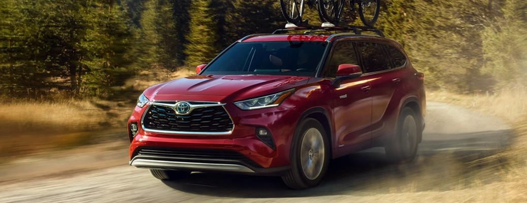 2021 Toyota Highlander driving down dirt road