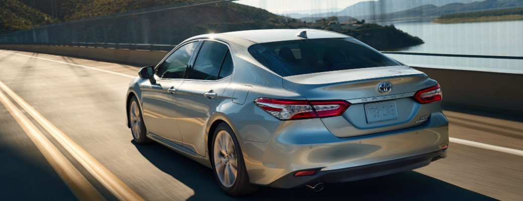 Rear view of 2020 Toyota Camry driving down road