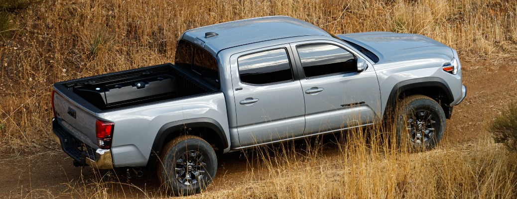 2021 Toyota Tacoma driving through grassy terrain