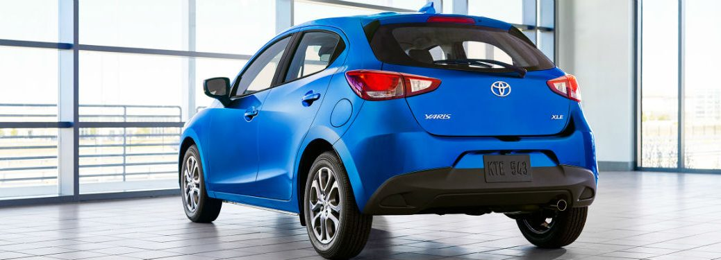 2020 Toyota Yaris Hatchback exterior back fascia and drivers side in room with windows