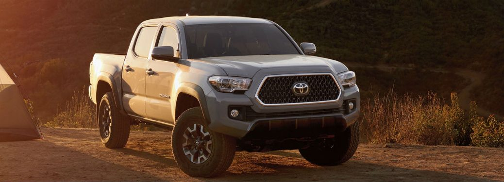 2019 Toyota Tacoma exterior front fascia and passenger side parked on campground