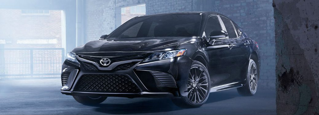 2019 Toyota Camry exterior front fascia and drivers side in brick building with fog