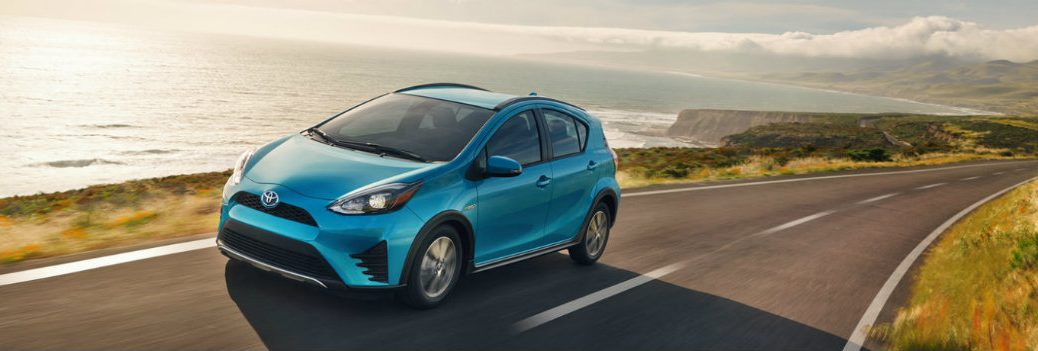 2018 Toyota Prius driving by the ocean
