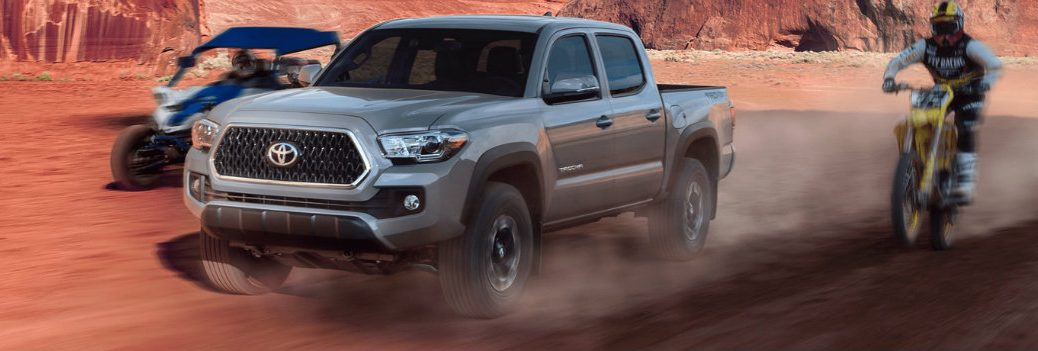 2020 Toyota Tacoma racing some dirt bikes