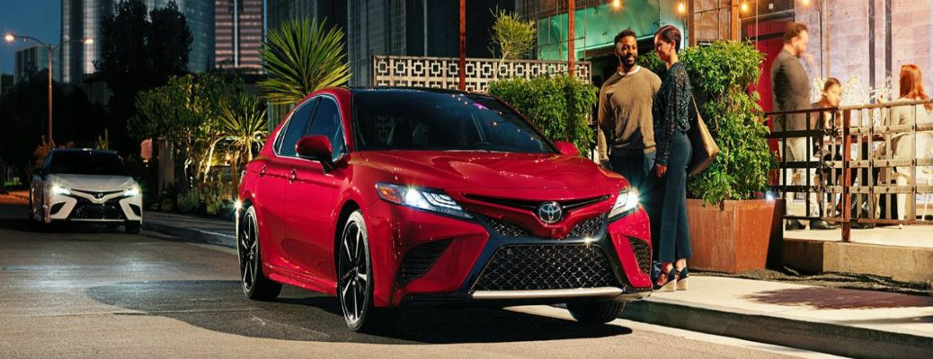 2020 Toyota Camry outside of a diner with a couple approaching