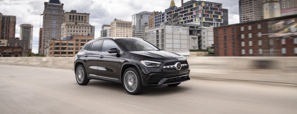 A black 2021 Mercedes-Benz GLA driving down an open road.