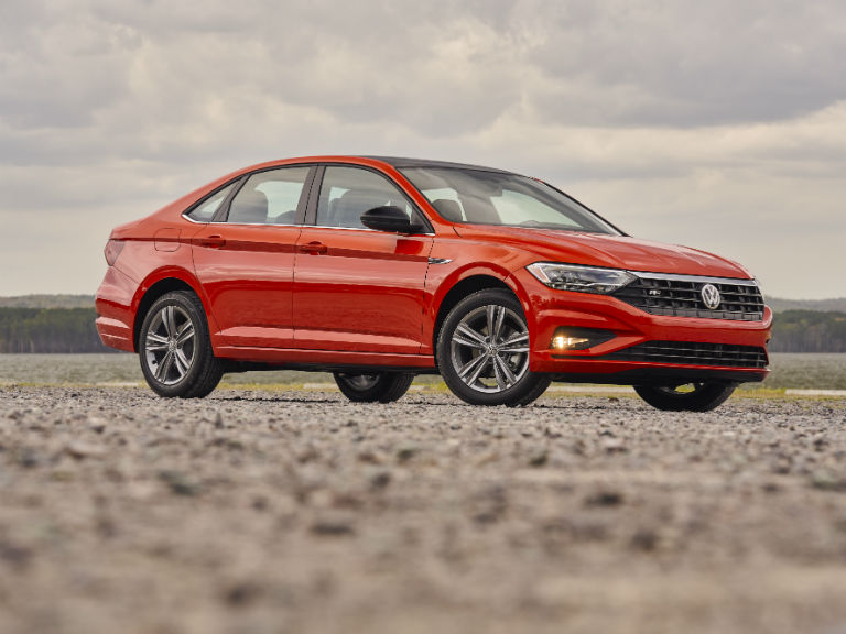 side view of a red 2019 Volkswagen Jetta