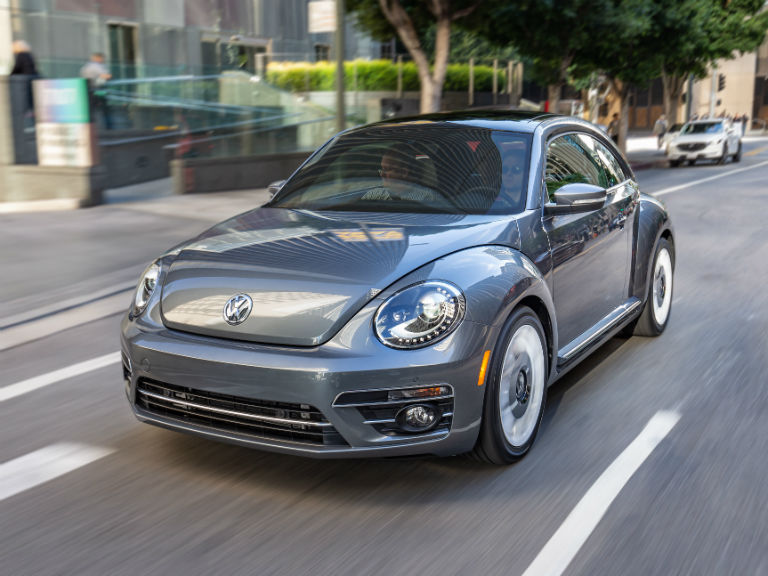 front view of a silver 2019 VW Beetle