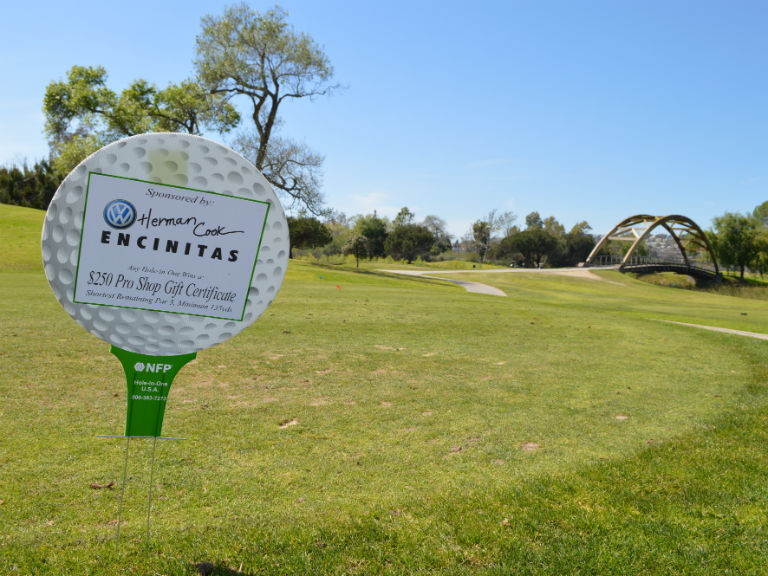 hole in one sponsor sign for Herman Cook VW
